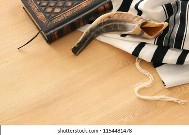 Prayer Shawl - Tallit, Prayer book and Shofar (horn) jewish religious symbols. Rosh hashanah (jewish New Year holiday), Shabbat and Yom kippur concept.