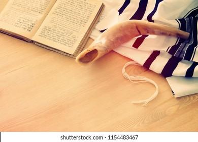 Prayer Shawl - Tallit, Prayer book and Shofar (horn) jewish religious symbols. Rosh hashanah (jewish New Year holiday), Shabbat and Yom kippur concept.