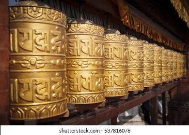 Prayer wheels made from metal at Swayambhunath Temple, Kathmandu, Nepal
