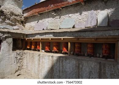 prayer wheels on exterior of Lamayuru gompa monastery, Ladakh, India