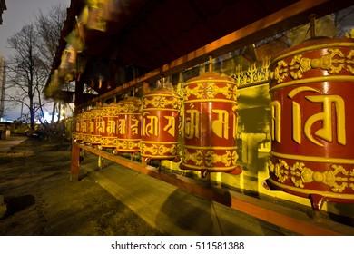 Prayer wheels at Saint Petersburg Buddhist Temple Datsan Gunzechoyney at night