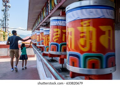 Prayer wheels, at selective focus, at Zang Dhok Palri Phodang, a Buddhist monastery in Kalimpong in West Bengal, India.