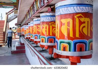 Prayer wheels, at selective focus, at Zang Dhok Palri Phodang, a Buddhist monastery in Kalimpong in West Bengal, India.