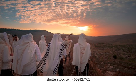 prayers With tefillin and shofar in sunset