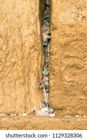 Prayers written on notes inserted into the western wall.