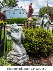 Praying angel statues in a Catholic church yard in Keyport New Jersey,