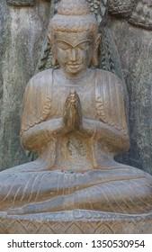 Praying Buddha statue