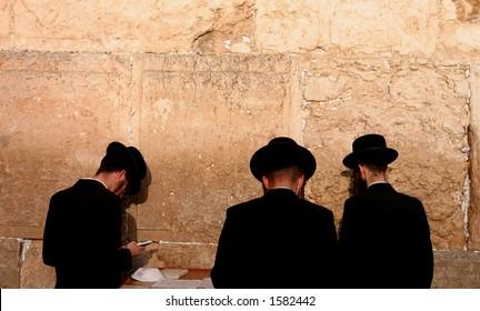 praying by the Western Wall, Jerusalem.