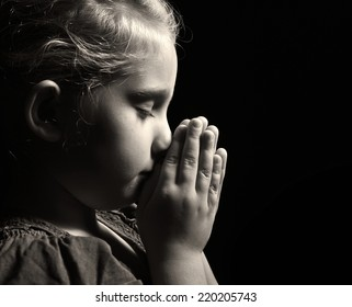 Praying child. MANY OTHER PHOTOS FROM THIS SERIES IN MY PORTFOLIO.