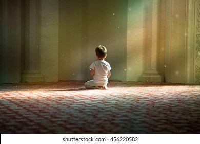 praying child in the White Mosque in Bulgar