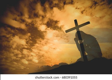 Praying with cross background