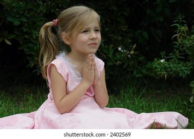 praying girl on the grass