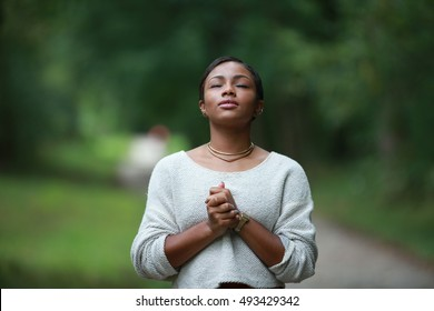 praying to god, posing african, american black, girl adult fashionable model, feeling moments, enjoying, happiness