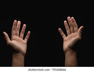 Praying hand in the dark