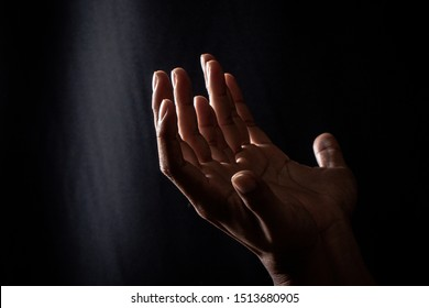 Praying hand Prayer requests for what is intended Or is less likely Is a wish from Holy things or gods, Hand on black background