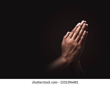 Praying hands with faith in religion and belief in God on dark background. Power of hope or love and devotion. Namaste or Namaskar hands gesture. Prayer position. - Shutterstock ID 1531396481