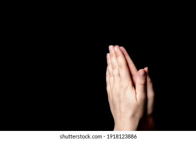 Praying hands with faith in religion and belief in God on blessing background. Power of hope or love and devotion in the dark with copy space , space for text