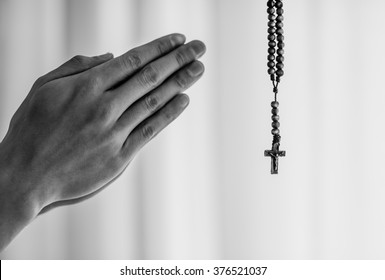 Praying hands and rosary.