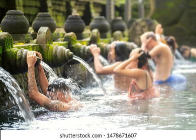 Praying in holy spring water of sacred pool at Pura Tirta Empul Temple, Tampaksiring