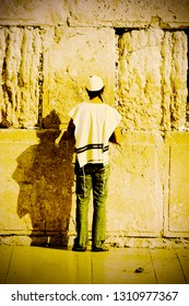 Praying Jew at the Western Wall of the Jerusalem Temple in Israel