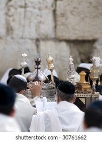 Praying Jewish with Torah scroll at Passover near the Western Wall