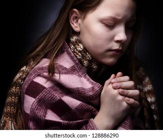 Praying little girl