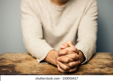 Praying man at desk