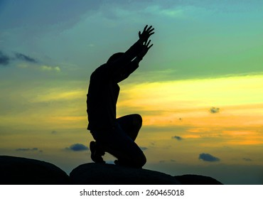 praying man on beautiful sky background