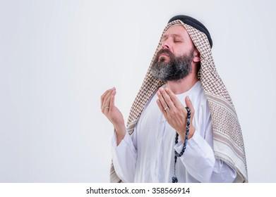 Praying middle eastern man.