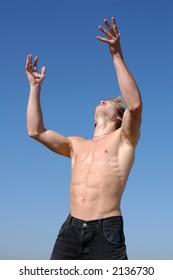 Praying muscular male model