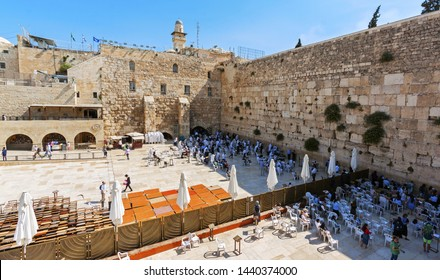 Praying people at the Wailing Wall. Visible division into two separate parts - for men and for women. Temple Mount, Jerusalem, Israel