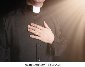 Praying priest