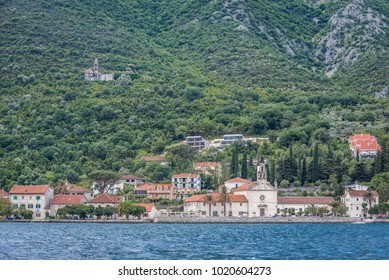 Prcanj, small coastal village in the Kotor Bay, Montenegro, view with St Nicholas church