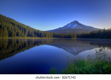 Pre Dawn Image Of Snow Capped Mount Hood Reflecting Off The Glass Smooth Surface Of Lake Trillium In Oregon In The Pacific Northwest.