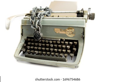 pre digital security - a lock and chain on an old manual typewrite