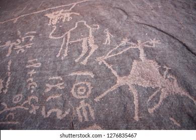 Pre Historic Paintings in a Rock in the Wadi Rum Desert in Jordan in the middle east.  Jordan, Petra, April, 2009