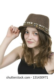 Pre teen young girl wearing a brown hat on white background