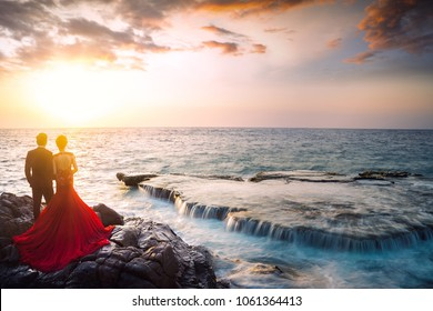 Pre wedding couple and Amazing landscape when the waves on a large rock and make an wonderful waterfall in Hang Rai at Nui Chua national park in sunlight, Ninh Thuan province, Viet Nam