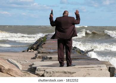 preacher giving praise in prayer on the shores of Lake Erie, Ohio