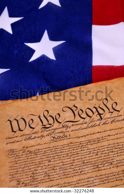 Preamble to the US Constitution with the stars and stripes in the background