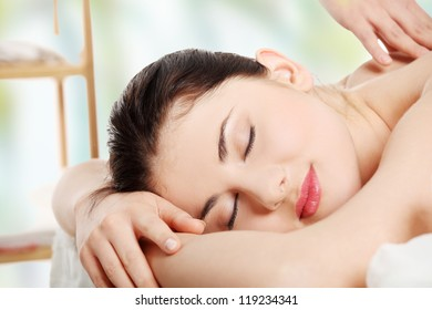 Preaty young woman relaxing beeing massaged in spa saloon