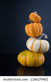 Precarious Squash and Pumpkin Tower with Copy Space