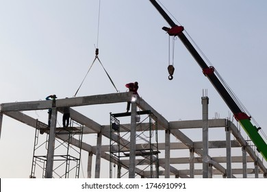 precast concrete beam installed at construction site by mobile crane  ; welding bar rod ; civil engineering background
