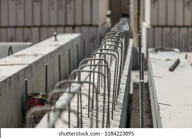 Precast concrete beam with outstanding reinforcement