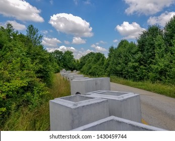 Precast Concrete Drop Boxes Drainage for Heavy Highway Construction for Transportation Roads stockpiled on the project site. DOT approved ASTM 1577 precast culverts under earth live loads. By Ted Webb