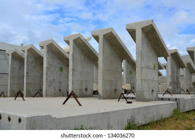 Precast concrete shapes are awaiting incorporation into a new bridge construction project