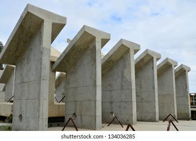 Precast concrete shapes are awaiting incorporation into a new bridge construction project