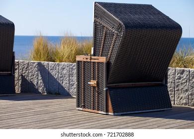 precious brown wicker beach chair on sylt promenade