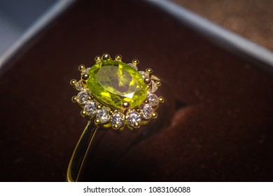 Precious golden ring with olive green stone, natural peridot.