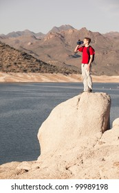 Precious Water (Young Man Drinking from Water Next to Desert Lake)
